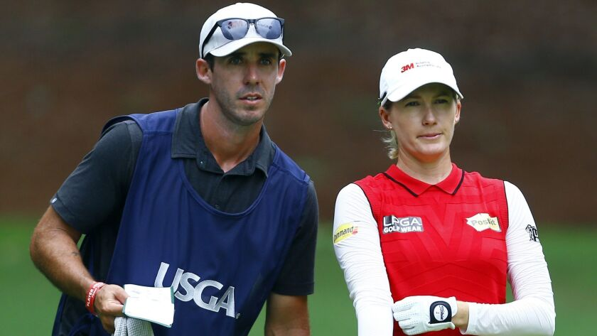 Sarah Jane Smith, of Australia, and her caddie husband, Duane Smith, talks about her tee shot on the