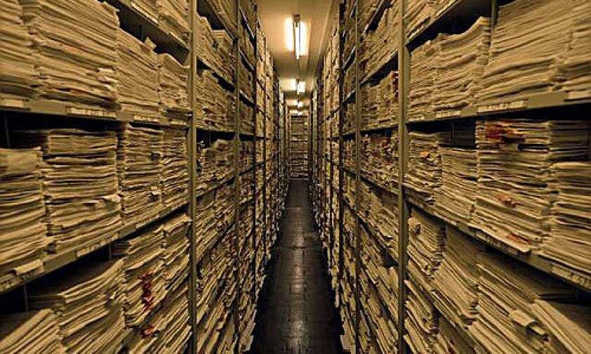 DOCUMENTATION: Auschwitz records line a shelf. The first exhibition of Ehrlich's portfolio will be at Craig Krull Gallery.