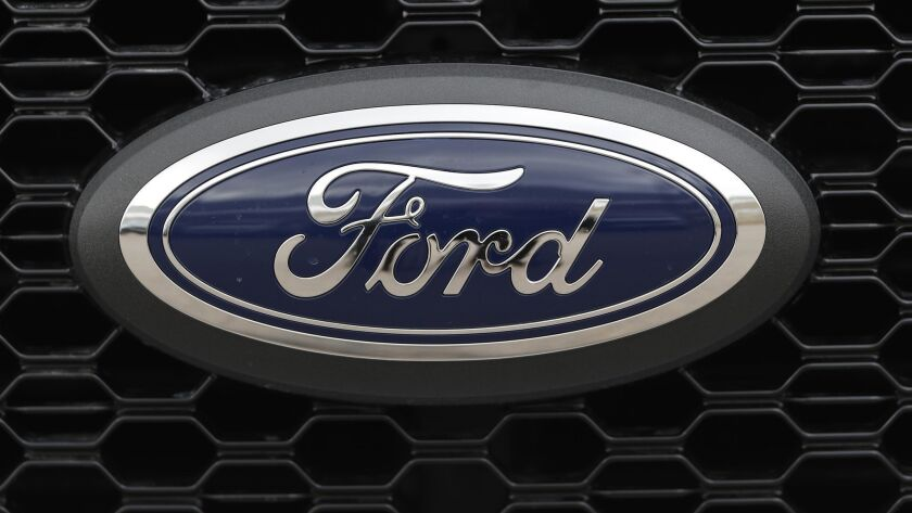 The Ford logo on the grille of a 2019 F-150 pickup truck.