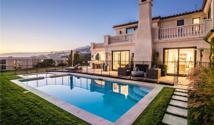 The two-story villa Brad Stuart has listed takes in sweeping ocean and golf course views.