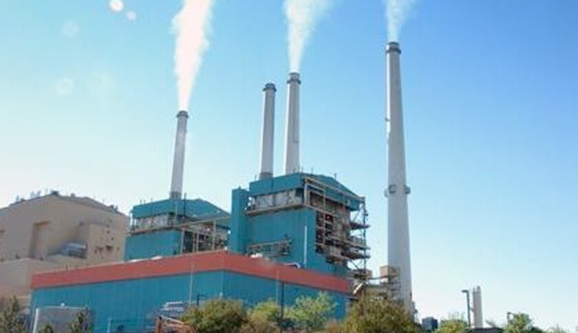 The Environmental Integrity Project looked at that civil penalties paid by polluters during the first six months under Trump. The group published an analysis Thursday that found penalties were less than half their levels under each of the past three presidents. In this July 1, 2013, file photo smoke rises from the Colstrip Steam Electric Station, a coal burning power plant in in Colstrip, Mont.