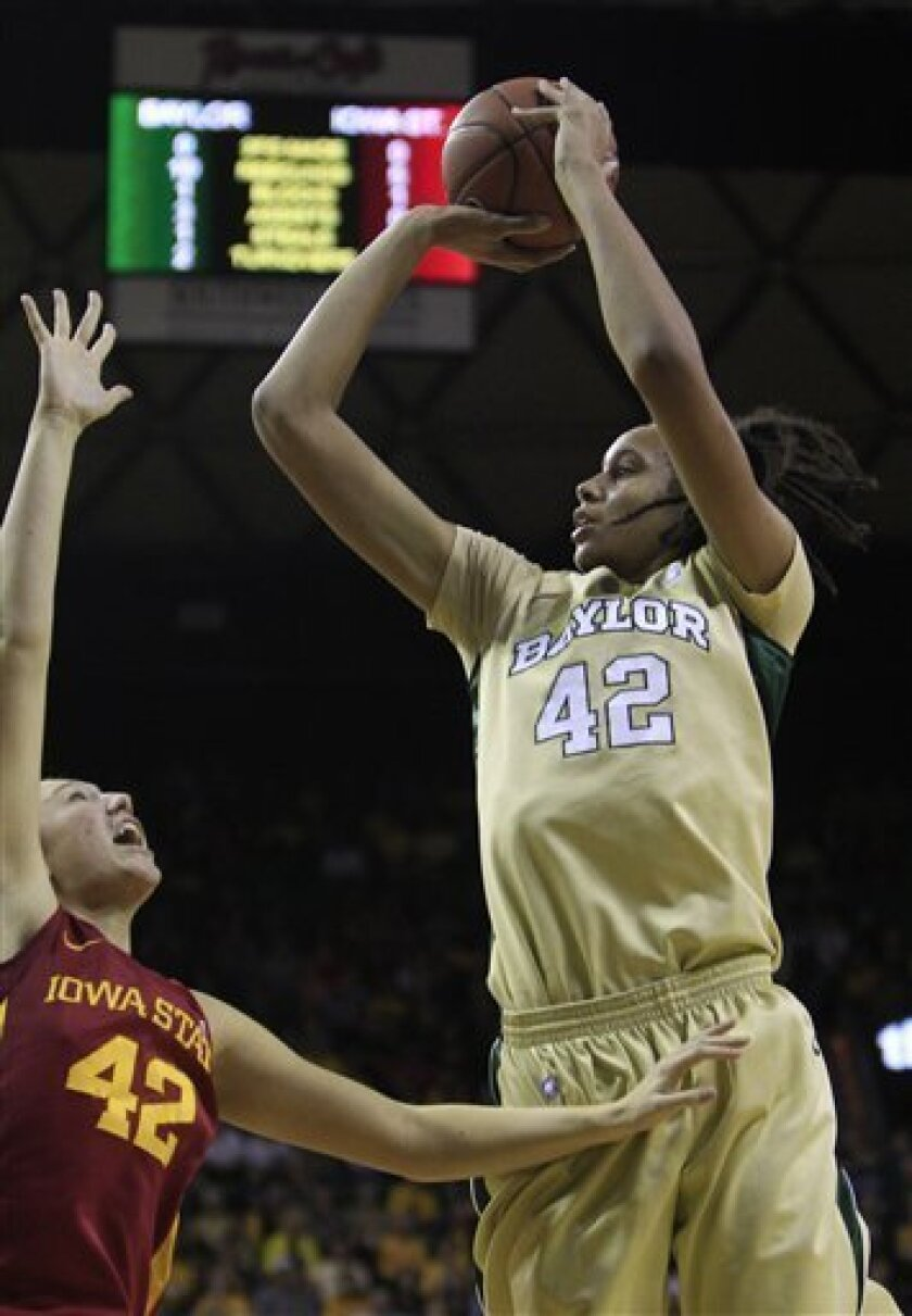 Baylor's Brittney Griner (42) shoots against Iowa State's Amanda Zimmerman (42) during the first half of an NCAA college basketball game in Waco, Texas on Saturday, Jan. 8, 2011. (AP Photo/LM Otero)