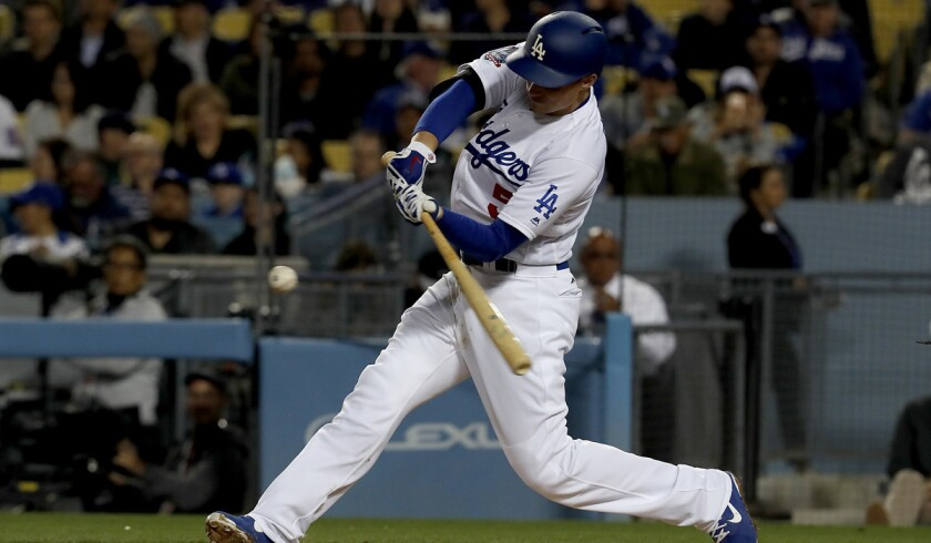 Dodgers shortstop Corey Seager connects for a double against the Miami Marlins in the third inning on April 24 at Dodger Stadium.