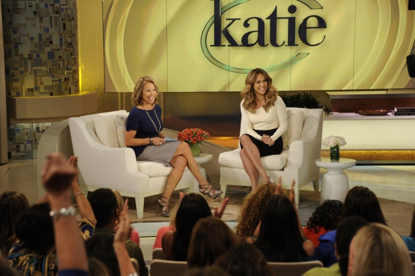 Katie Couric, left, on the set of her daytime talker, interviewing Jennifer Lopez.