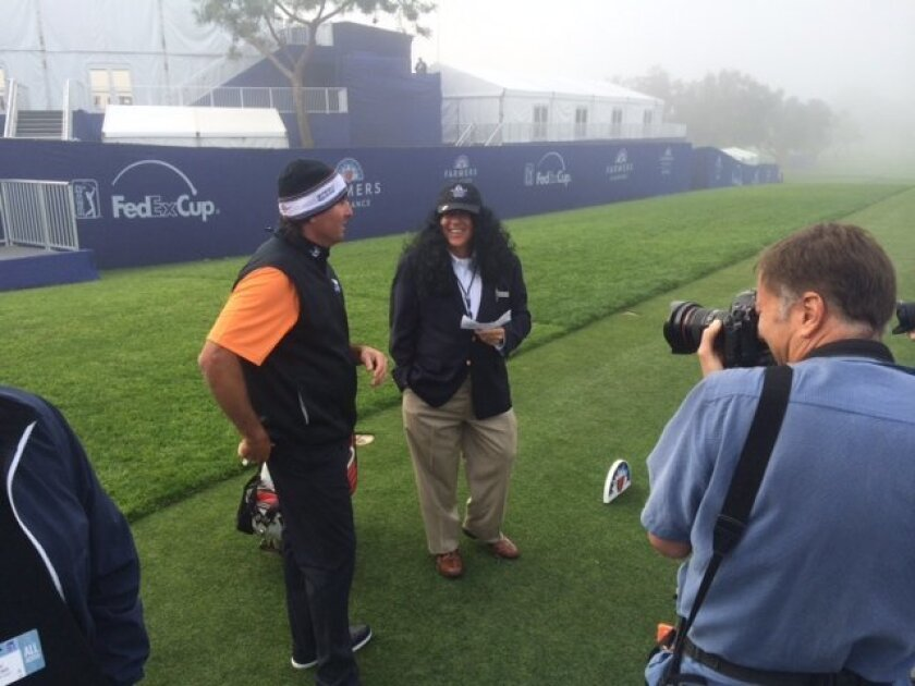Pat Perez gets a big surprise from his father Tony on the first tee when Tony sported long hair to make fun of his son's long hair.