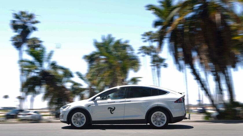 A Tesloop car drives near Mission Bay. The ride-sharing service offers trips between cities such as