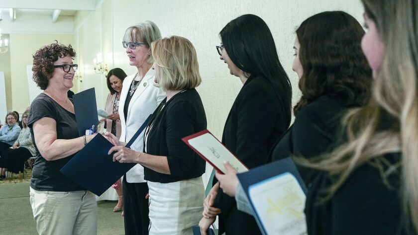 Retiring teacher Mary Schindler shakes hands with Burbank Mayor Emily Gabel-Luddy and local politica