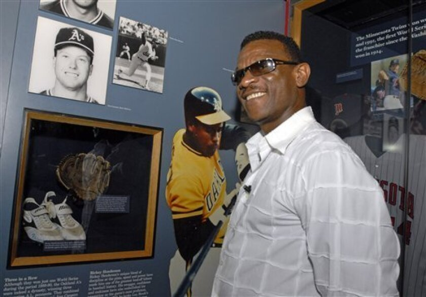 Class of 2009 Baseball Hall of Fame inductee Rickey Henderson enjoys a tour of the National Baseball Hall of Fame and Museum in Cooperstown, N.Y., on Friday, May 8, 2009. At lower left are shoes he wore when he tied Lou Brock's stolen base record. (AP Photo/Tim Roske)