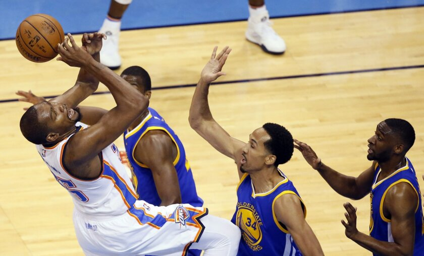 Oklahoma City Thunder forward Kevin Durant (35) is fouled by Golden State Warriors guard Shaun Livingston (34)during the first half in Game 3 of the NBA basketball Western Conference finals  in Oklahoma City, Sunday, May 22, 2016. (AP Photo/Sue Ogrocki)