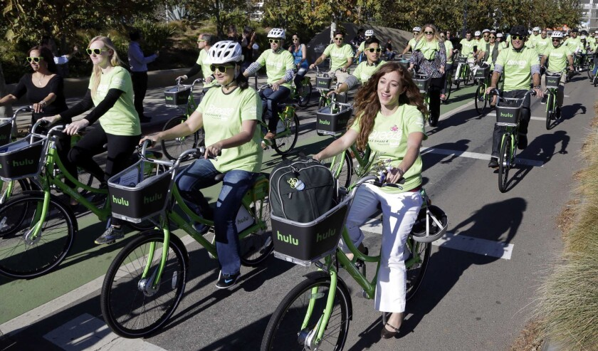 Riders test out new bicycles as part of a bike-share program in Santa Monica on Nov. 12, 2015.