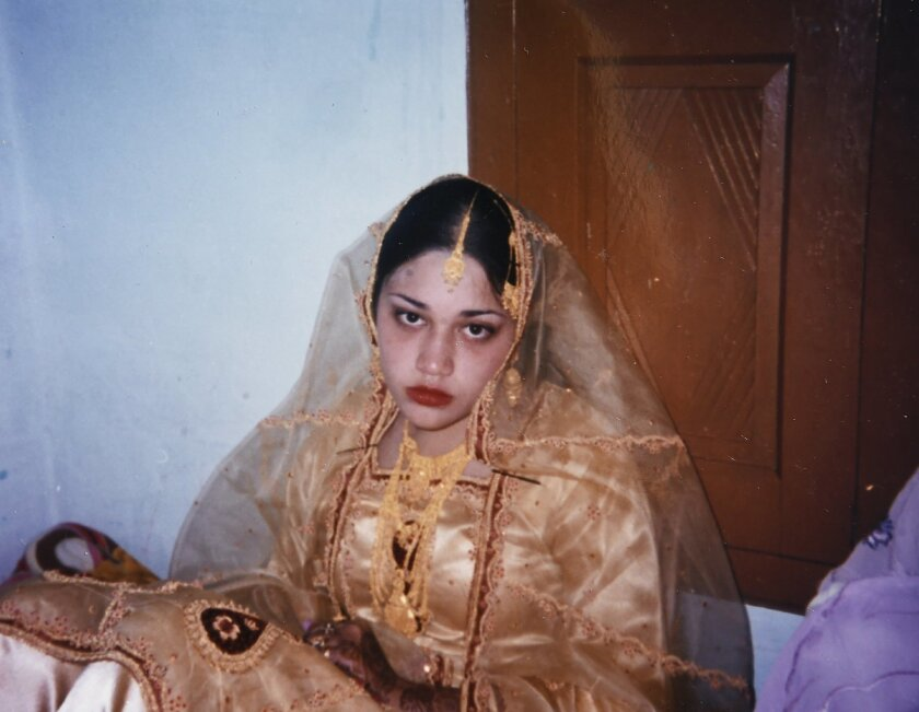 This Jan. 6, 2006 photo provided by Naila Amin shows her at the age of 15, in Pakistan, on the second day of her marriage ceremony. Amin says her parents, who brought her to the U.S. as a 4-year-old, grew wary of her American-style social life when she entered her teens and the ensuing friction led