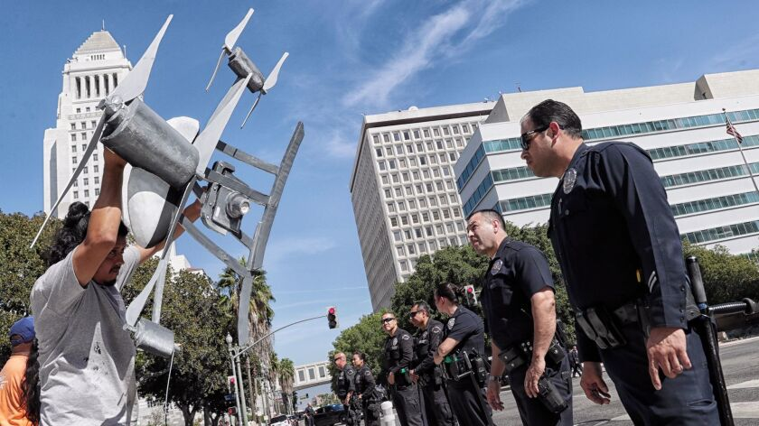 LOS ANGELES, CA, TUESDAY, OCTOBER 17, 2017 - Miguel Guzman flaunts a drone replica in front of LAPD