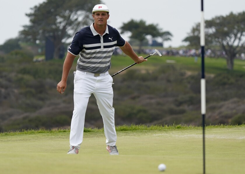 Bryson DeChambeau watches his putt miss the cup on the 13th green during the final round of the U.S. Open Golf Championship, Sunday, June 20, 2021, at Torrey Pines Golf Course in San Diego. (AP Photo/Marcio Jose Sanchez)