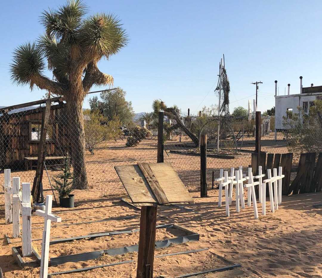 White crosses and other art installations in the desert