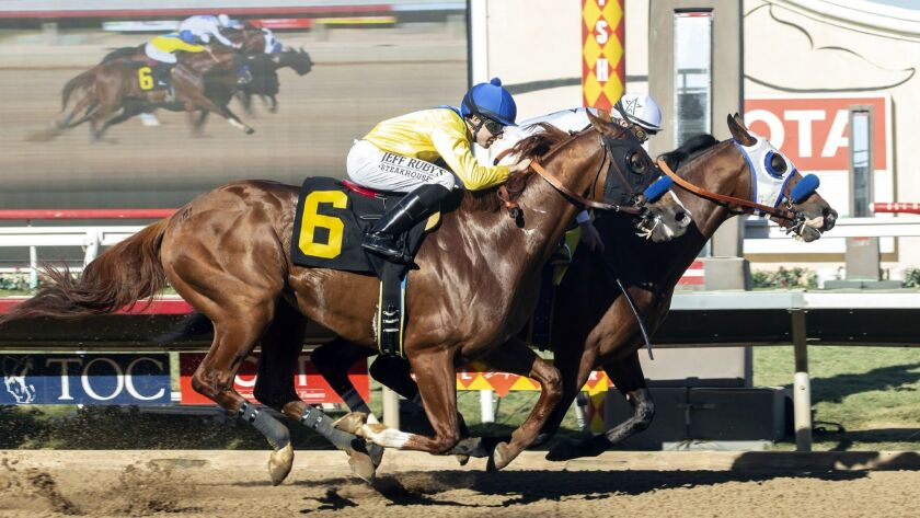 In a photo provided by Benoit Photo, Battle of Midway and jockey Flavien Prat, right, outleg Dabster