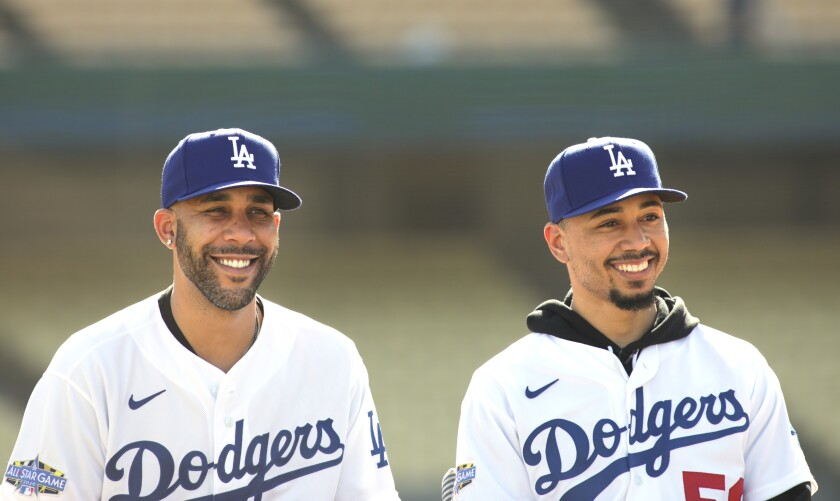 David Price and Mookie Betts are introduced at Dodger Stadium on Wednesday.