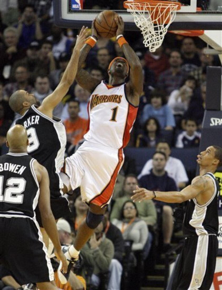 Golden State Warriors' Stephen Jackson (1) shoots over San Antonio Spurs' Tony Parker, top left, during the first half of an NBA basketball game Monday, Feb. 2, 2009, in Oakland, Calif. (AP Photo/Ben Margot)