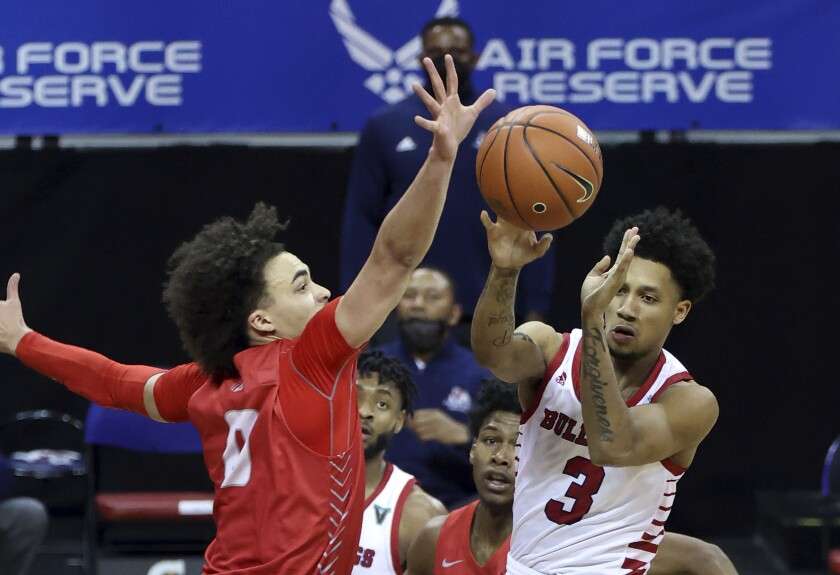 Fresno State guard Isaiah Hill (3) passes the ball as New Mexico guard Isaiah Marin (0) defends during the second half of an NCAA college basketball game in the first round of the Mountain West Conference men's tournament Wednesday, March 10, 2021, in Las Vegas. (AP Photo/Isaac Brekken)