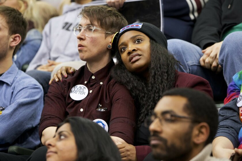 A couple embraces while listening to Democratic presidential candidate Sen. Bernie Sanders, I-Vt., speak during a campaign rally at Chicago State University in Chicago, Thursday, Feb. 25, 2016. (AP Photo/Jacquelyn Martin)