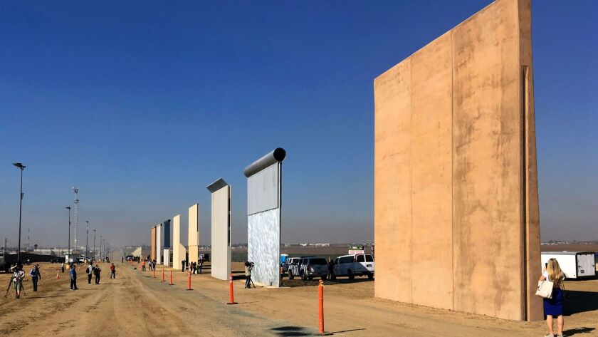 FILE - This Oct. 26, 2017, file photo shows prototypes of border walls in San Diego. President Donal