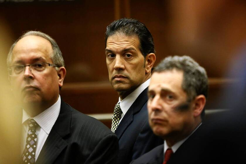 More charges were filed against tax consultant Ramin Salari, center, flanked by attorneys Mark Hathaway, left, and Mark Werksman.