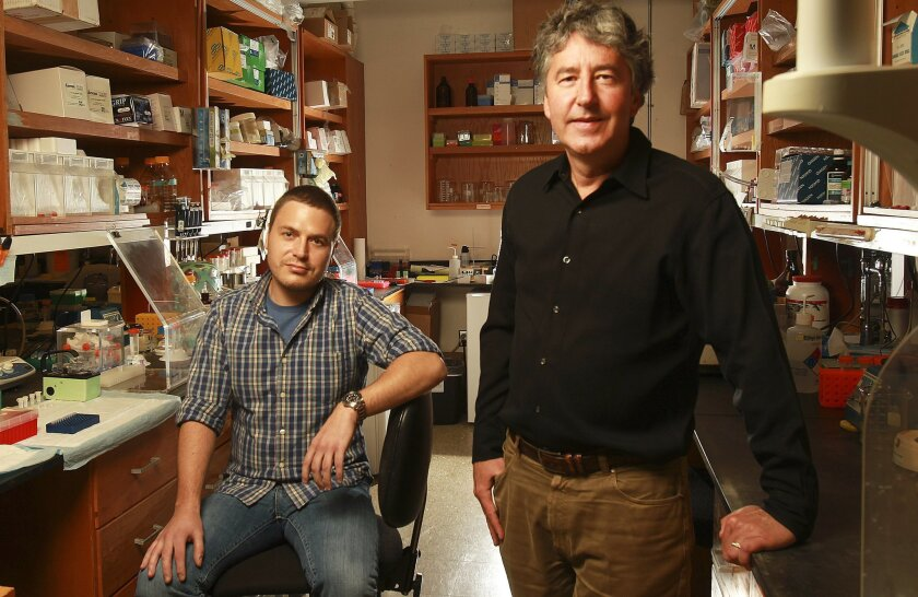 Gerald F. Joyce, right, studies the origins of life at The Scripps Research Institute. A team headed by Joyce and post doctorate fellow Jon Sczepanski evolved an enzyme that could help explain the RNA world hypothesis.
