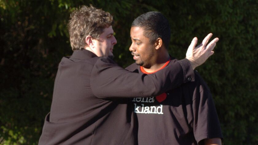 Tony Hicks, left, and Marcus Thompson give a pull half-hug January 10, 2007, in Walnut Creek, Califo