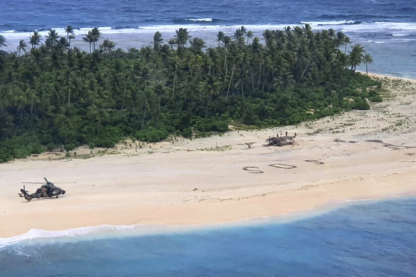 Three missing men were found after searchers spotted their SOS sign in the sand at Pikelot Island.