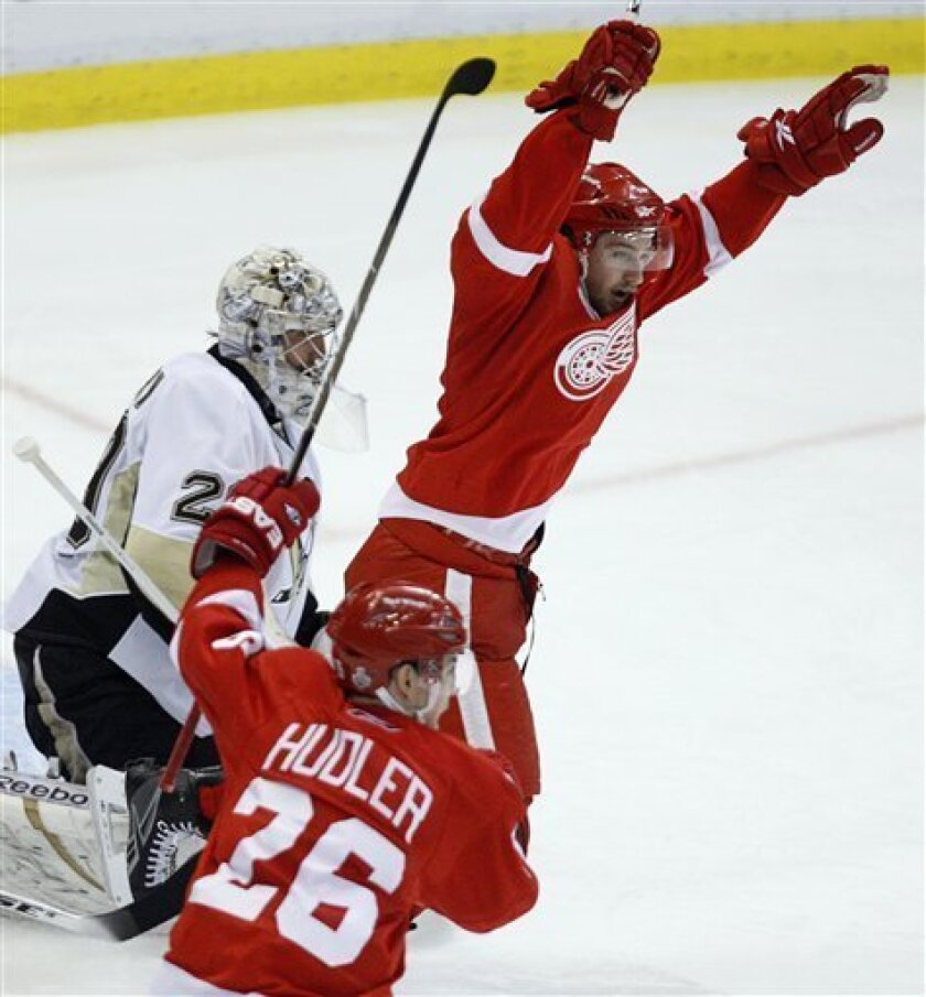 Detroit Red Wings' Darren Helm, right, and Jiri Hudler (26), of the Czech Republic, celebrate teammate Jonathan Ericsson's goal against Pittsburgh Penguins goaltender Marc-Andre Fleury, left, during the second period of Game 2 of the NHL hockey Stanley Cup finals in Detroit on Sunday, May 31, 2009.