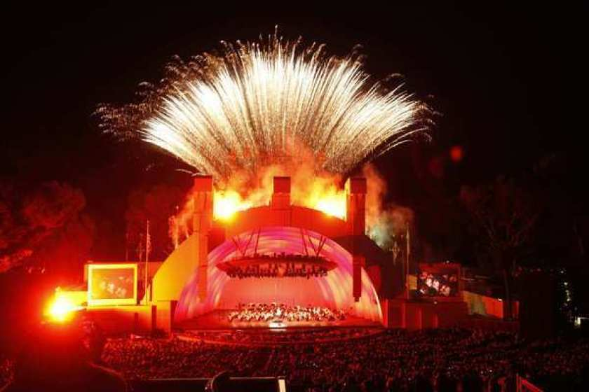 An archival photo of fireworks shooting from the top of the Hollywood Bowl.