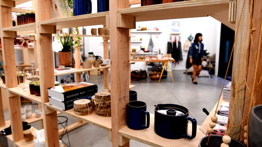 A worker organizes merchandise at Poketo, a pop-up shop in Culver City.