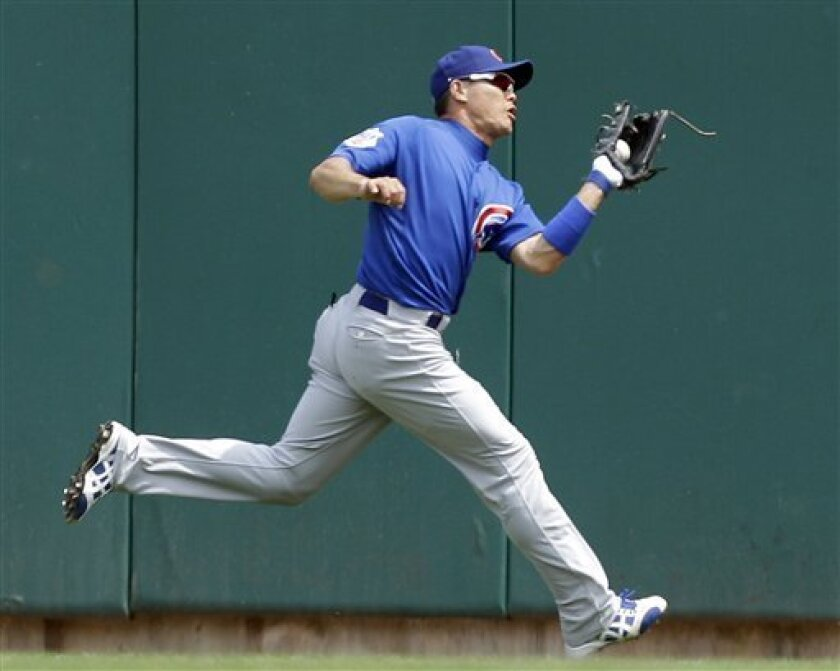 Chicago Cubs right fielder Kosuke Fukudome catches a ball hit by St. Louis Cardinals' Daniel Descalso for an out during the fifth inning of a baseball game on Sunday, June 5, 2011, in St. Louis. (AP Photo/Jeff Roberson)