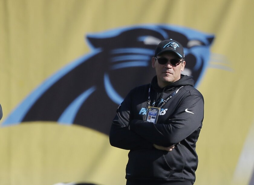 Carolina Panthers head coach Ron Rivera watches his team stretch during practice in preparation for the Super Bowl 50 football game Friday Feb. 5, 2016 in San Jose, Calif. (AP Photo/Marcio Jose Sanchez)