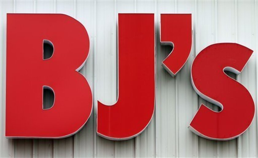 FILE - In this Aug. 16, 2010 file photo, a bold BJ's sign is seen outside the store in Portland, Maine. BJ's Wholesale Club Inc.'s fiscal fourth-quarter net income fell 81 percent Wednesday, March2, 2011, burdened by a hefty expense tied to some club closings. (AP Photo/Pat Wellenbach)