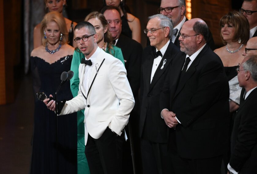 "FILE - In this June 12, 2016 file photo, playwright Stephen Karam accepts the Tony award for Best Play for ""The Humans"" onstage at the Tony Awards in New York. For all next week, Broadway-goers not in the mood for a musical will have only one option. ""The Humans,"" Karam's play about a fractious fam"