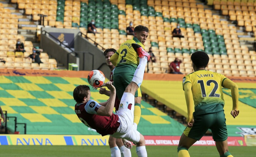 Burnley's Chris Wood scores his side's opening goal during the English Premier League soccer match between Norwich City and Burnley at Carrow Road Stadium in Norwich, England, Saturday, July 18, 2020.(Lindsey Parnaby/Pool via AP)