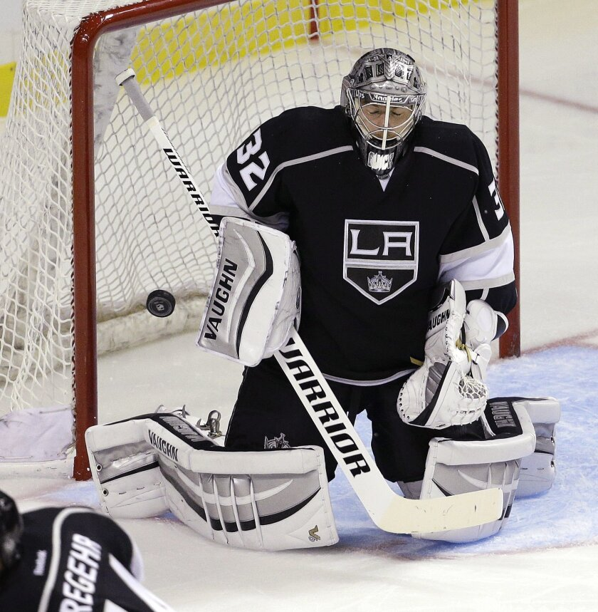 Los Angeles Kings goalie Jonathan Quick makes a save during the second period of their NHL preseason hockey game against the Colorado Avalanche on Saturday, Oct. 4, 2014, in Las Vegas. (AP Photo/John Locher)
