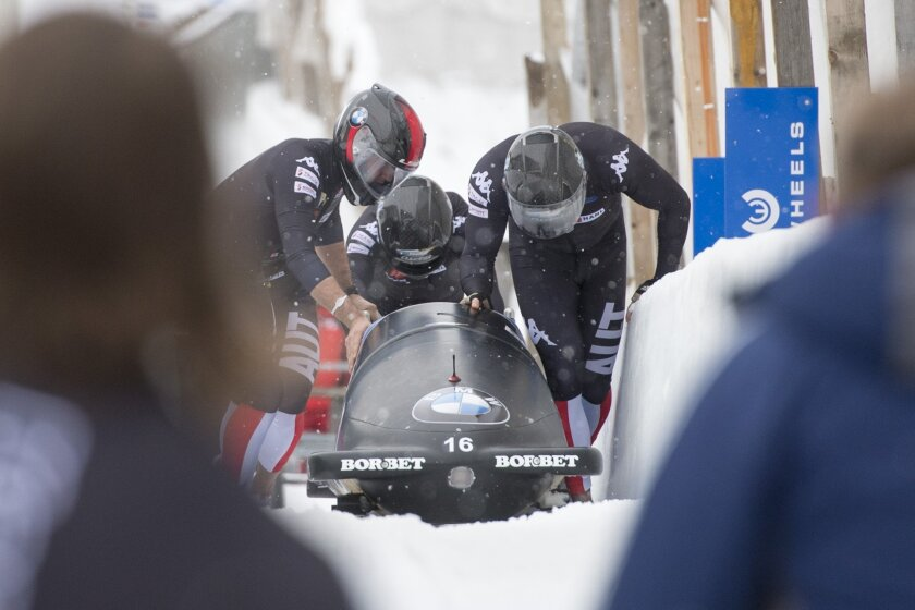 Austria's Benjamin Maier, Marco Rangl, Markus Sammer and Danut Ion Moldovan push their bob in the finish area during  the men's 4-man bobsled  World Cup competition in St. Moritz, Switzerland, Sunday, Feb. 7,  2016.  The Austrians placed second.  (Urs Flueeler/Keystone via AP)