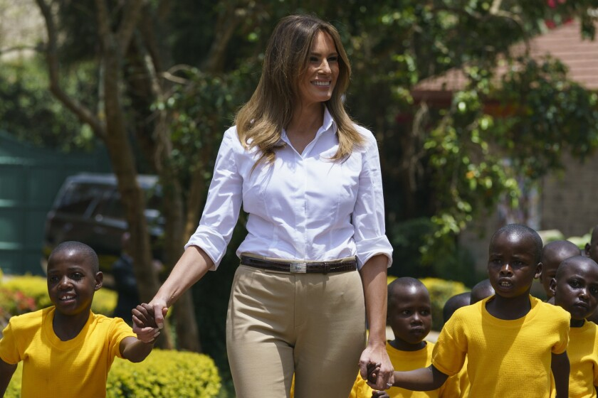 First Lady Melania Trump walks with children during a visit to the Nest Orphanage in Limuru, Kenya, earlier this month.