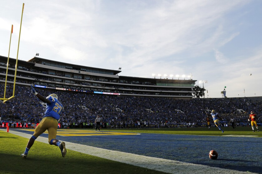 UCLA running back Joshua Kelley celebrates after scoring a touchdown against USC last year.