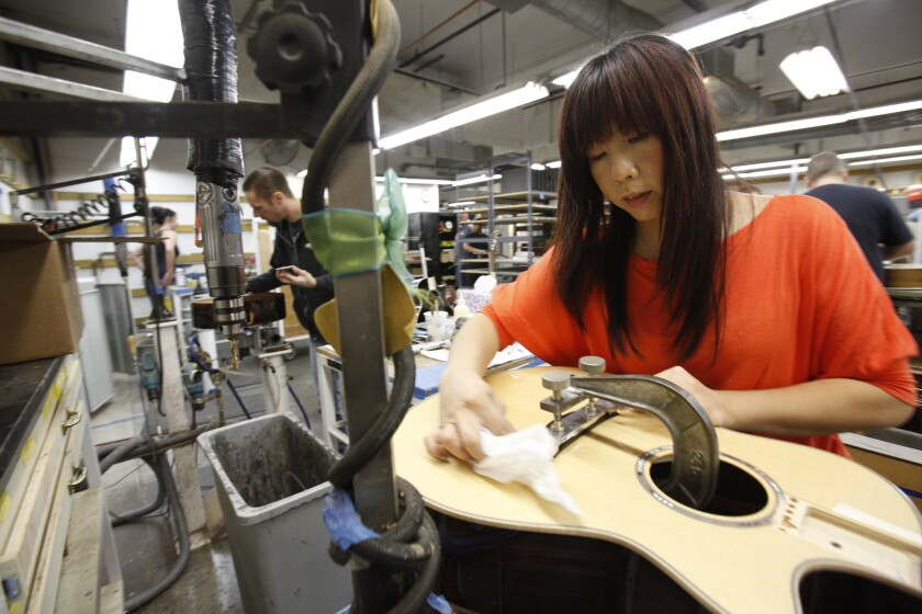 Taylor Guitars employees create the company's musical instruments at their El Cajon facility in 2012.