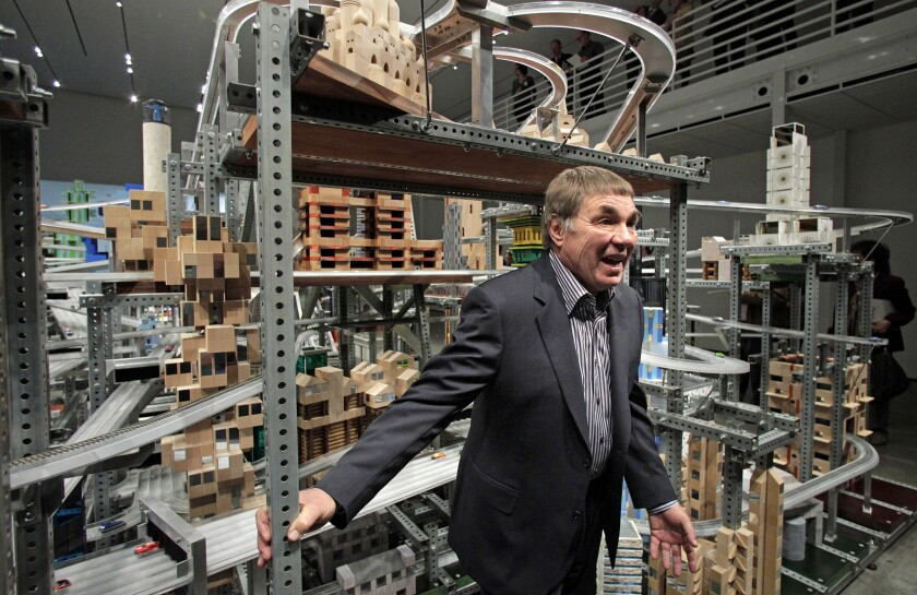 "In this 2012 photo, Chris Burden stands in front of his kinetic sculpture ""Metropolis II"" at the Los Angeles County Museum of Art."