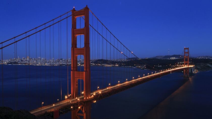 SAN FRANCISCO , CA., June 20, 2013: The Golden Gate Bridge lives up to its name while it glistens in