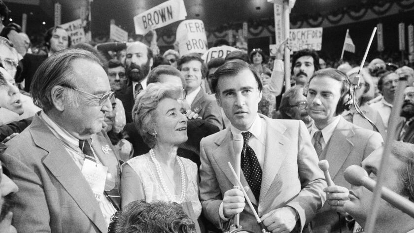 With his father, left, and mother looking on, California Gov. Jerry Brown turns over California's votes to Jimmy Carter at the Democratic National Convention in 1976.