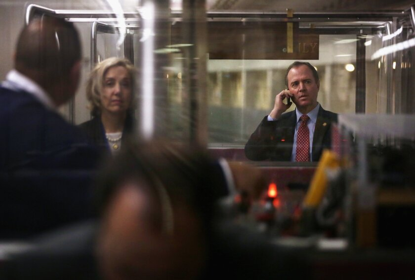 Rep. Adam Schiff (D-Burbank) talks on his phone while riding the House subway on Jan. 28 on Capitol Hill.
