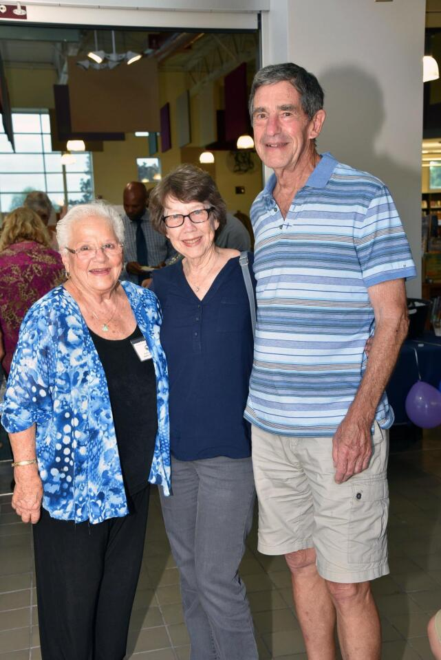 Friends of Solana Beach Library board member Mary Jane Boyd, Pam and Mike Dalton