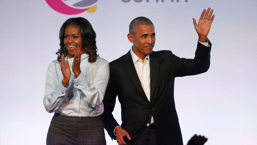 Former First Lady Michelle Obama and former President Obama and arrive for the Obama Foundation Summit in Chicago on Oct. 13.