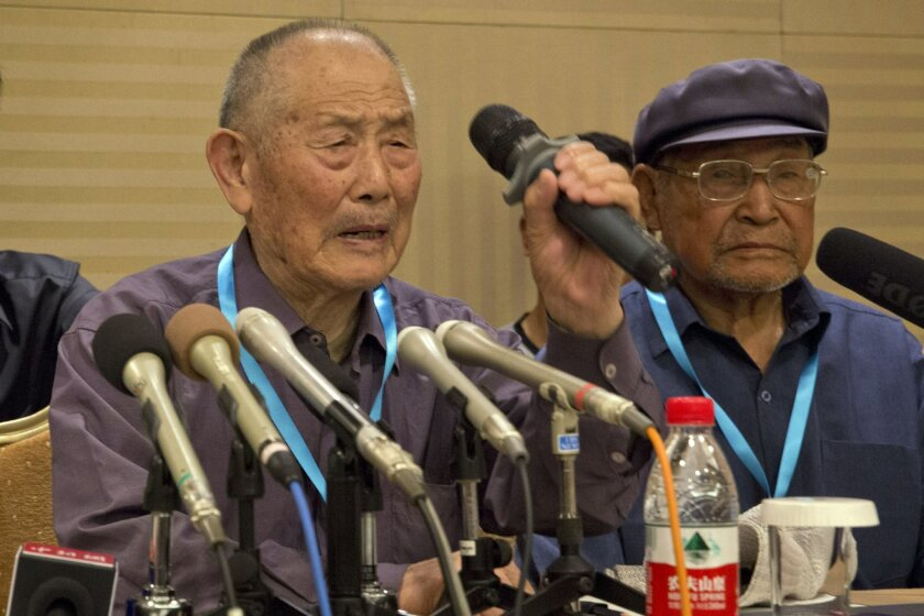 Former forced laborer Yan Yucheng, 87, attends a press conference to announce a settlement with Mitsubishi Materials Corp. held in Beijing, China, Wednesday, June 1, 2016. Mitsubishi Materials Corp., one of dozens of Japanese companies that used Chinese forced laborers during World War II, reached