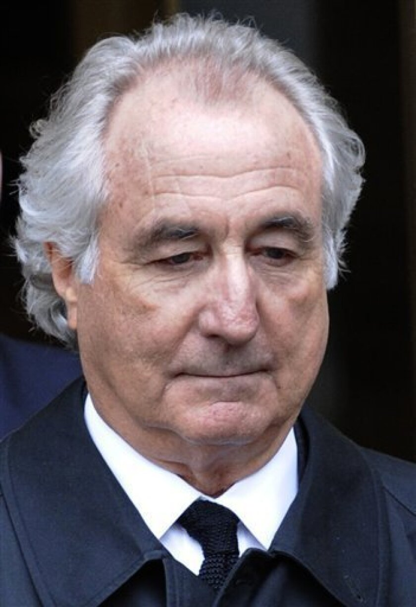 FILE - In this March 10, 2009 file photo, Bernard Madoff exits Manhattan federal court in New York. Madoff has decided against appealing his 150-year sentence for a multi-billion dollar fraud, Ira Sorkin, Madoff' lawyer, said Thursday, July 9, 2009. (AP Photo/Louis Lanzano, file)