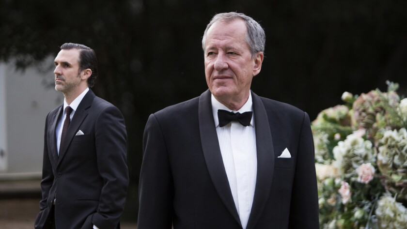 "Paul Schneider, left, and Geoffrey Rush in the movie ""The Daughter."""